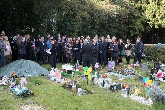 Mourners gather around the graveside for the funeral of a baby girl, who was found dead on a footpath earlier this year (Getty Images),