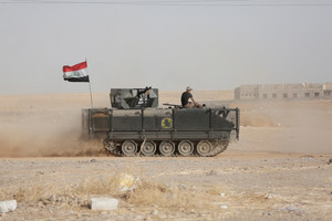 An Iraqi military vehicle advances toward Mosul (Reuters)