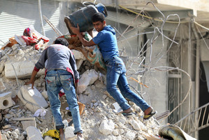 People remove belongings from a damaged site after an air strike in the rebel-held besieged neighbourhood of Aleppo (Reuters)