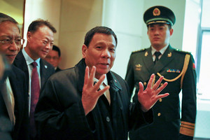 Philippines president Rodrigo Duterte arrives at a Beijing hotel (Reuters)