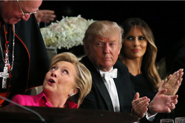 Donald Trump looks at Hillary Clinton after speaking at the Alfred E. Smith Memorial Foundation dinner (Reuters)