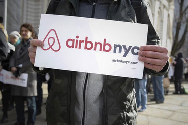 Supporters of Airbnb stand during a rally (Reuters)