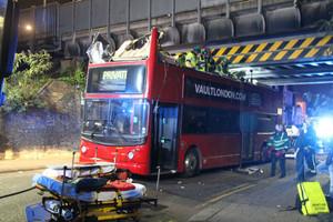 Bridge slices top off double decker bus in London