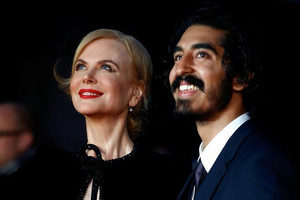 """Nicole Kidman (L) poses alongside Dev Patel as they arrive for the gala screening of the film """"Lion"""" (Reuters)"""
