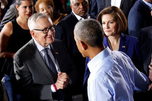 US President Barack Obama is greeted by US Senate Democratic leader Harry Reid (L) and US Senate Candidate Catherine Cortez Masto (R) (Reuters)
