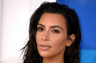 Kim Kardashian drops lawsuit over 'faked' robbery story