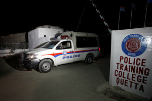 A police truck is seen at a gate to the Police Training Center after an attack on the center in Quetta (Reuters)
