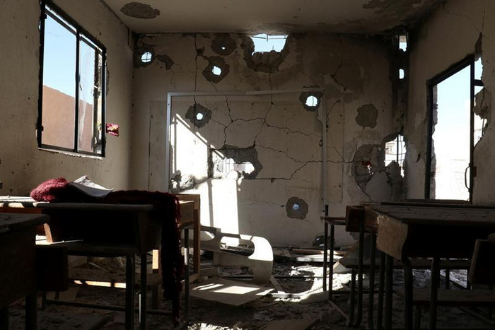 A damaged classroom is pictured after shelling in the rebel held town of Hass (Reuters)