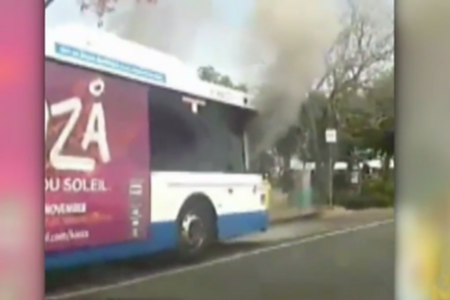 Smoke billowing from the cabin of the bus (7News)