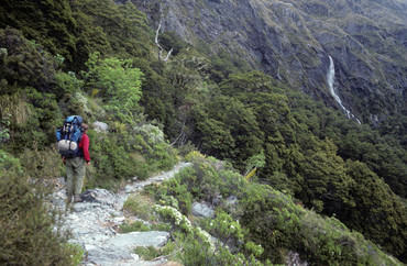 A tramper walking a mountain trail (File)