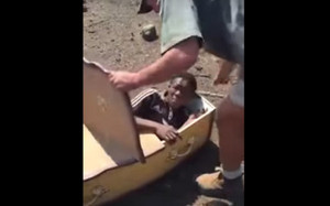 Victor Rethabile being forced into a coffin (Twitter/EFFSouthAfrica)