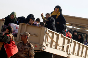 Displaced Iraqi people during a battle with Islamic State militants in Mosul (Reuters)