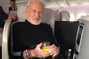 Mr Aldrin's manager, Christina Korp, tweeted a photo of him on the flight home (Christina Korp / Twitter)