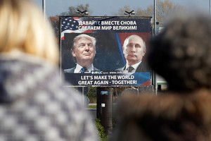 A billboard showing a pictures of US President-elect Donald Trump and Russian President Vladimir Putin is seen in Danilovgrad (Reuters)