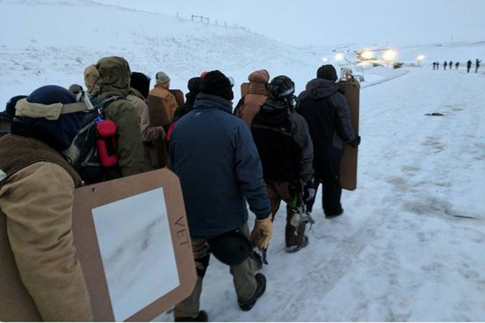 Veterans walk toward Standing Rock, where they plan to form a human shield between authorities and protesters. (Ruth Hopkins/Twitter)