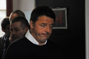 Italian Prime Minister and Democratic Party leader Matteo Renzi arrives to cast his vote (Getty)