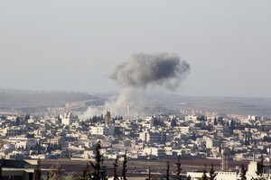 Smoke rises after airstrikes by pro-Syrian government forces in Anadan city, Northern Alleppo countryside