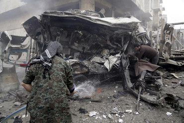 A site hit by what activists said were three consecutive air strikes carried out by the Russian air force (Reuters)