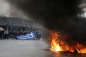 Angry farmers clash with police in Athens