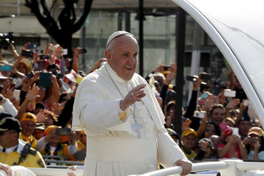 Pope Francis waves to the crowd on his way to celebrate mass at the Guadalupe's basilica in Mexico City (Reuters)