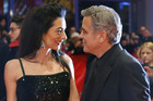 Clooneys discuss refugees with Merkel