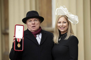 Singer, songwriter and musician Van Morrison poses for photos with his daughter Shana Morrison after being knighted by Britain's Prince Charles at Buckingham Palace (Reuters)