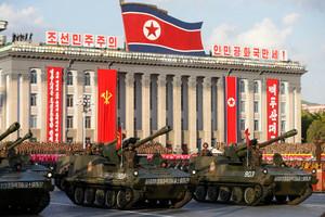 North Korea launches long-range rocket 'with satellite'