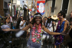 Street processions, block parties and big-budget parades are the hallmark of the festival (Reuters)