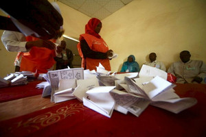 Officials count the ballots after a referendum in El Fasher (Reuters)