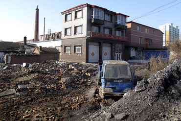 A truck is seen next to a coal field in Hegang, Heilongjiang Province, China (Reuters)