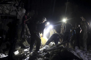 Civil defence members search for survivors after an airstrike at a field hospital (Reuters)
