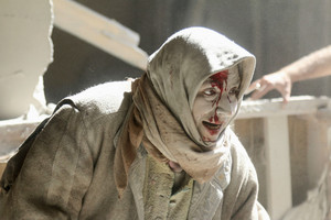 An injured woman reacts at a site hit by airstrikes in the rebel held area of Old Aleppo (Reuters)