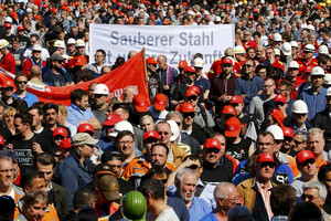 A banner reads: 'Cleaner steel is the future' at a metal workers' demonstration for higher wages (Reuters)