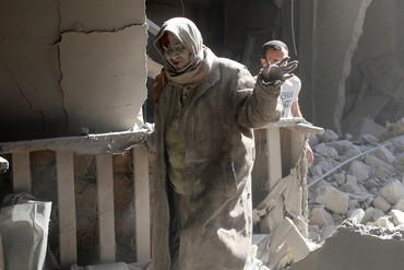 A woman reacts at a site hit by airstrikes in Aleppo, Syria, (Reuters)