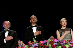 US President Barack Obama stands between WHCA President Carol Lee and Jerry Seib of The Wall Street Journal during a presentation of colours at the White House Correspondents' annual dinner (Yuri Gripas / Reuters)