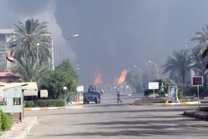 Flames rise after car-bomb attack at Taji (Getty)