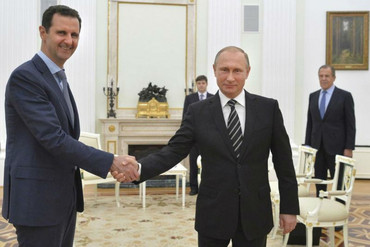 Russian President Vladimir Putin (R) shakes hands with Syrian President Bashar al-Assad during a meeting at the Kremlin in Moscow (Reuters)