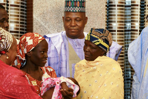 Rescued schoolgirl Amina Ali Darsha Nkeki presents her child to President Muhammadu Buhari in Abuja, Nigeria (Reuters)