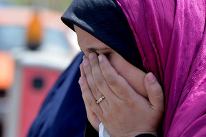 A relative of passenger onboard missing EgyptAir flight MS804 cries at Cairo International Airport (Getty)