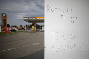 """A placard reads """"total rupture of all fuels"""" at a Total petrol station in Vertou, France (Reuters)"""