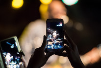 Cellphones are everywhere so can livestreaming of events be policed? (Getty)