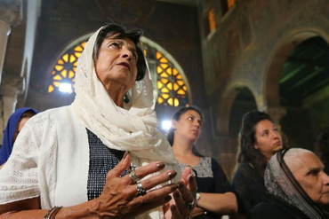 Families of EgyptAir victims at the absentee funeral mass at the main Cathedral in Cairo (Reuters)