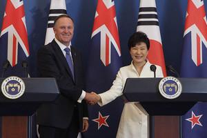 John Key shakes hands with South Korea's President Park Geun-Hye (Reuters)