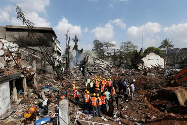 Rescue personnel at the site of the explosion on the outskirts of Mumbai (Reuters)