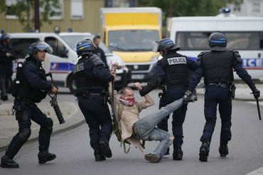 French police apprehend a man during rallies against the Government's proposed labour law reforms (Reuters)