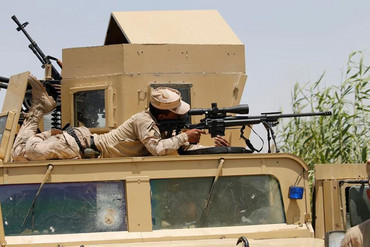 An Iraqi security forces sniper looks through the scope of his rifle near Falluja, Iraq (Reuters)