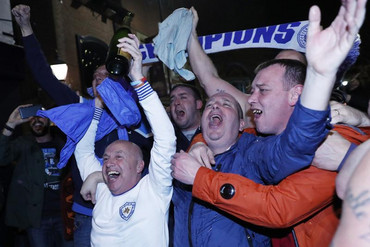 Leicester City fans celebrate (Reuters)