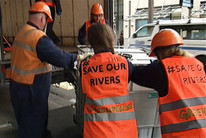 Greenpeace protesters deliver stinky message to ACC