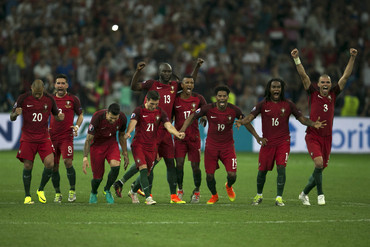Portugal players celebrate during penalty shootout (Getty Images)