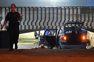 NSW Police personnel are seen after a vehicle crashed through the roller door of the car park of the Merrylands Police Station (AAP)